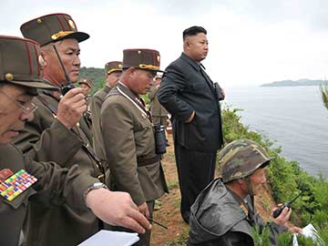 North Korea's Kim Jong-un Issues Warning at Live Rocket Firing Drill