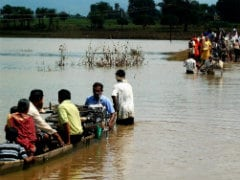 Boatmen Rescue Marooned People in Odisha