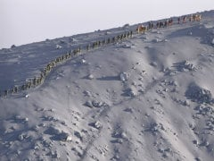 Three More Bodies Found on Japan Volcano as Typhoon Nears