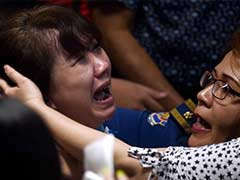 As AirAsia Passengers' Bodies are Found, Grieving Relatives Faint