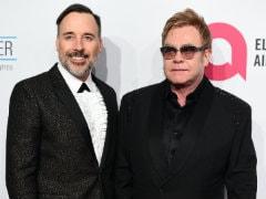 Elton John And David Furnish Young