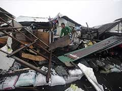 Philippine Typhoon Weakens But Leaves 21 Dead