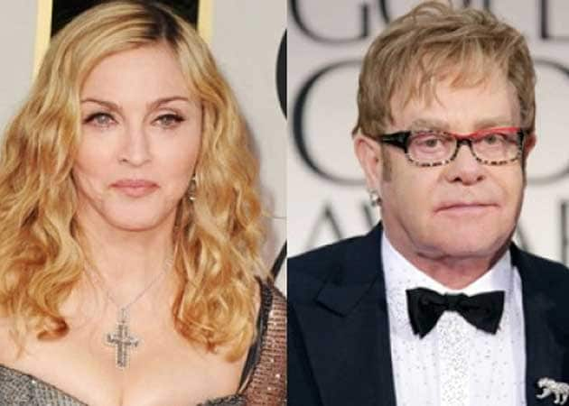 "Madonna has ""forgiven"" Sir Elton John for calling her a ""fairground stripper"""