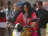 Sonakshi Sinha gets bike riding lesson from Ajay Devgn
