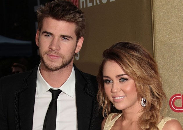 and Singer Miley Cyrus and her Hunger Games star boyfriend Liam ...
