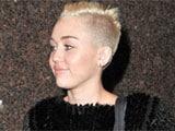 Miley Cyrus shaves head