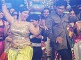 Shah Rukh Khan kisses belly-dancer on <i>India's Got Talent</i>