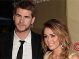Miley Cyrus wears engagement ring, denies calling off wedding
