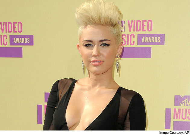 Miley Cyrus is in pain due to neck injury - NDTV Movies
