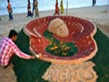 Indian Sand Artist Creates Satyajit Ray's Sculpture at Cannes