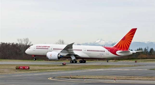A Dreamliner in Air India colours at an airport in Washington