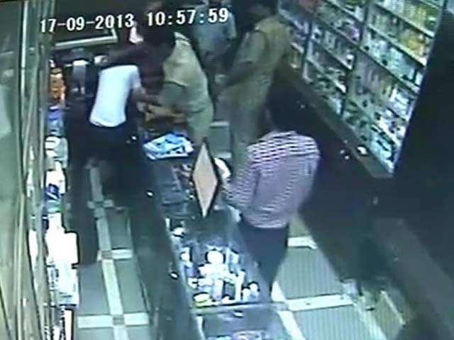 Video : Caught on camera: rogue police guards beat up Delhi chemist