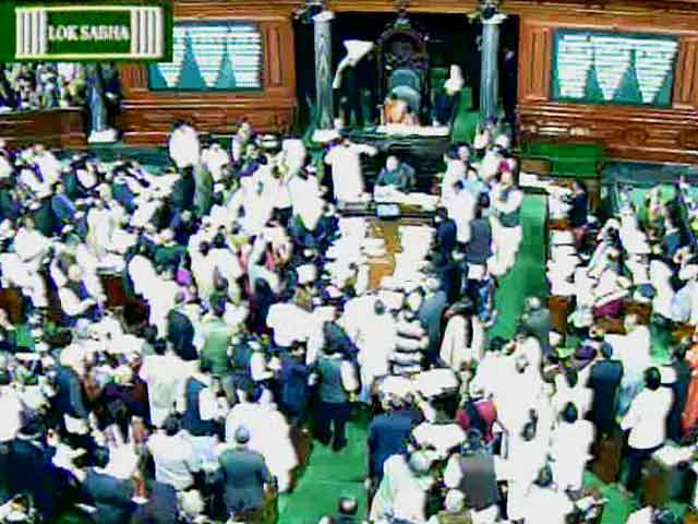 Video : Telangana Bill passed in Lok Sabha by voice vote, no live telecast