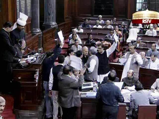 Video : Amid chaos and slogans, Rajya Sabha clears Telangana Bill