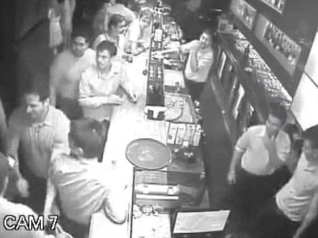 Video : Caught on Camera: Man Molests Woman in Pub, Then Opens Fire