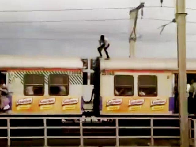Video : Police Searches For Man Who Decided To Stunt It Up On Mumbai Local