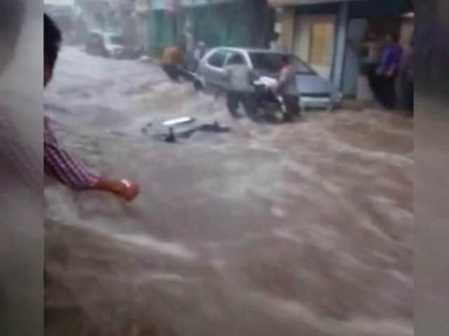 Video : Caught On Camera: Bike Swept Away In Flooded Street In Mathura