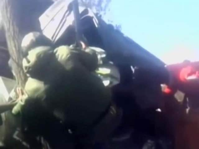 Video : Caught On Camera: Kashmiri Youth Rescue Soldier Trapped Inside Damaged Vehicle