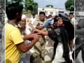 Video : Uttar Pradesh policemen suspended for beating up woman