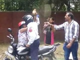 Video : Delhi Cop Caught On Camera Attacking Woman With Brick