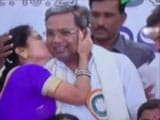 Video : Kiss And Tale: Woman's Surprise Greeting For Siddaramaiah