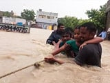 Video : Ropes Used To Rescue People From Flooded Homes In Andhra's Guntur