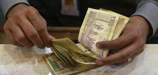 Rupee hits 63.77 against dollar to fresh record low