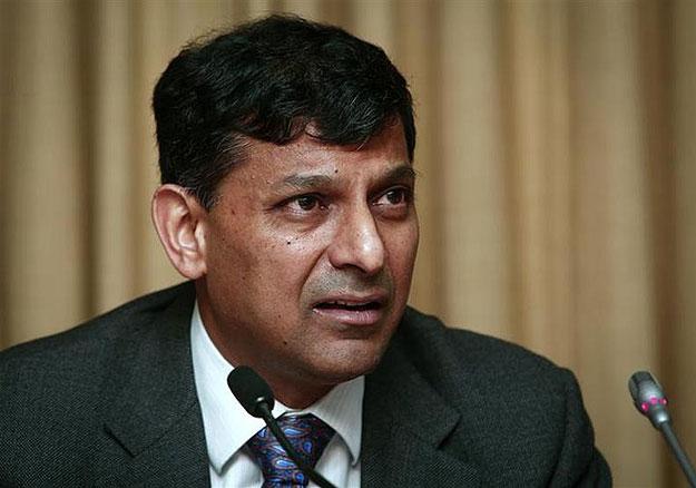 Raghuram Rajan surprises markets with rate hike, Sensex sinks