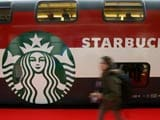 Starbucks cafe sales heat up slightly in latest quarter