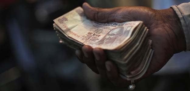 Rupee overvalued, should trade at 70/dollar: Rajwade