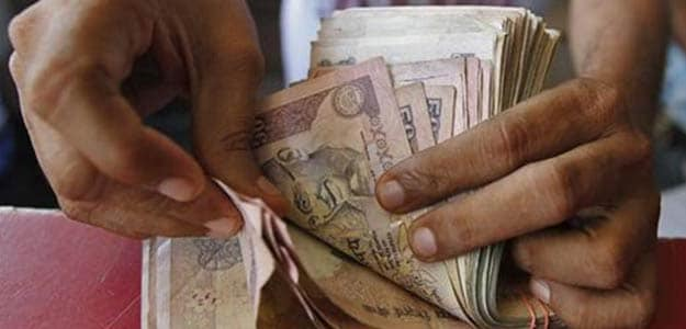 Rupee Slips to 59.30 Tracking Weakness in Shares