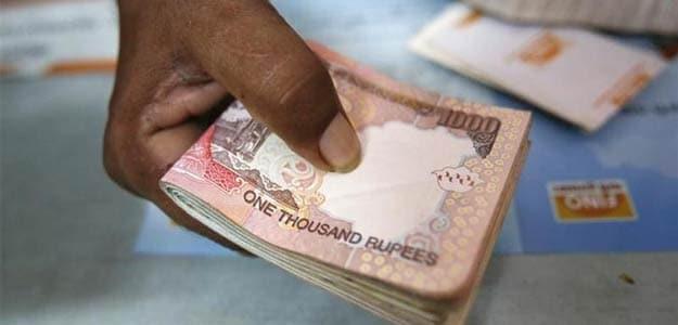 Rupee Slips to 59.36 Per Dollar