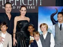 "Angelina Jolie Says Brad Pitt Felt ""Uneasy"" When Daughters Asked to Get Inked"
