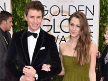 Eddie Redmayne Eyes Beach Vacation With Wife Post Oscars