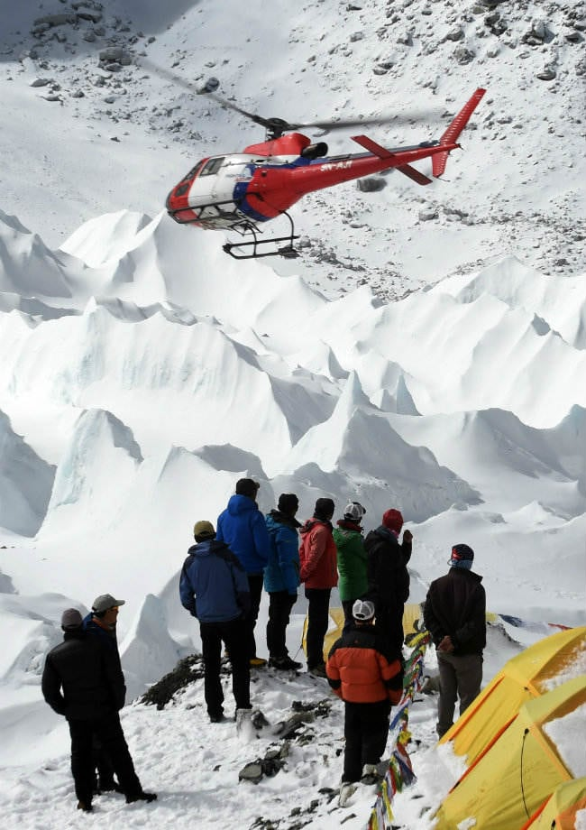 rescue teams airlift climbers stranded at high altitude on. Black Bedroom Furniture Sets. Home Design Ideas
