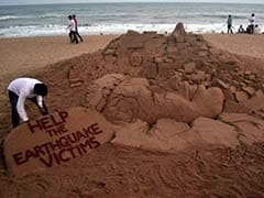 Sand Artist's Message for Helping Earthquake Victims