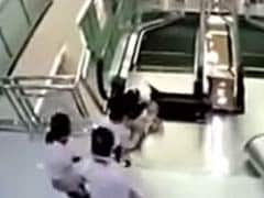 Chinese Woman Dies After Falling Into Escalator, But Saves Son