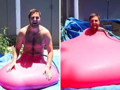 Giant Water Balloon Bursts In Slow Motion With Man Inside Enjoy
