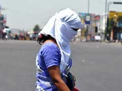 Police Check IDs of Women Riding Bikes With Covered Faces