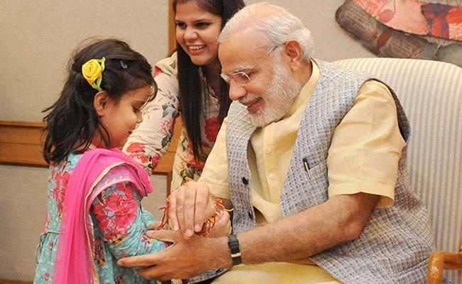 Women, Children Tie Rakhis to Prime Minister Narendra Modi