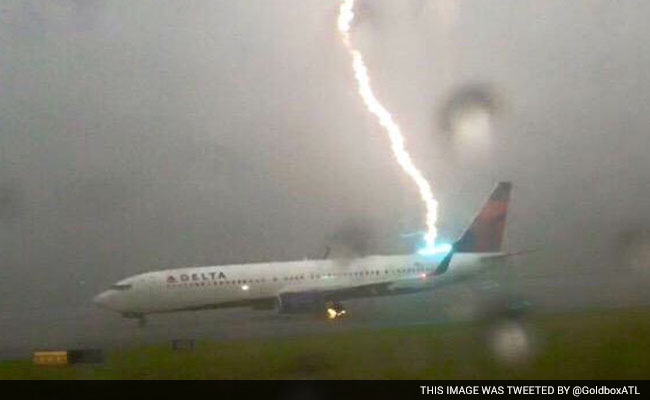 caught on camera scary moment when lightning strikes plane
