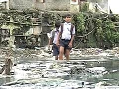 For 200 Kids Who Walk Through Sewage to School, Finally, a Bridge