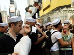 Hundreds of Couples Reenact 'Times Square Kiss' in New York