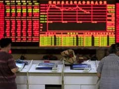Asia Shares Slump as China Sets Yuan Lower, Triggers Circuit Breaker
