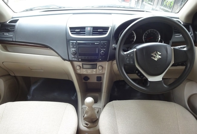 Ford figo aspire vs maruti swift dzire comparison review for Swift vxi o interior