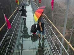 China's New Glass Bridge Tests Courage of Tourists