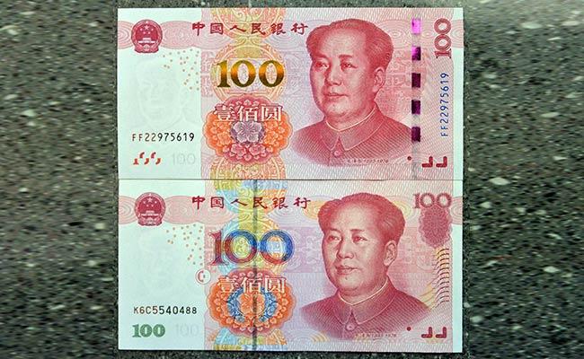 China's Yuan Hits 11-Year Low Amid Trade Tensions