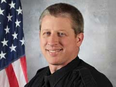 Officer Killed in Colorado Shooting was a Co-Pastor, Skating Champion