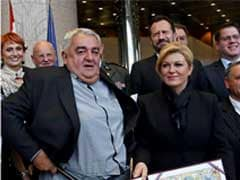 Croatia Rights Chief's Trousers Fall Down at Presidential Photoshoot