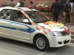 Minister Makes Green Statement, Rides Electric Car to Parliament